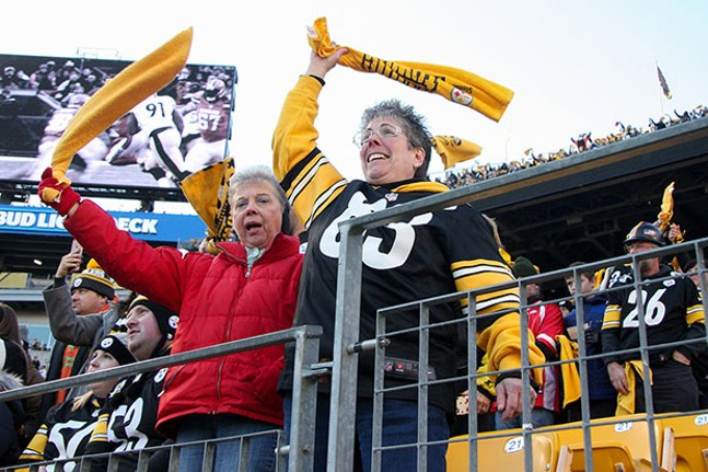Steelers fans waving the Terrible Towel at Heinz Field - CP PHOTO BY LUKE THOR TRAVIS