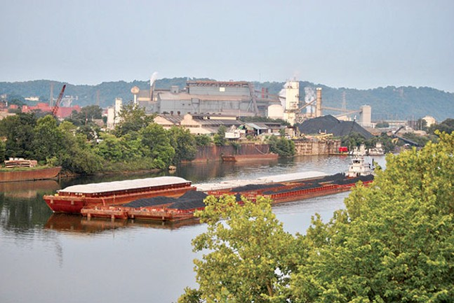 A coal barge on the Monongahela River in Braddock - CP PHOTO BY JAKE MYSLIWCZYK