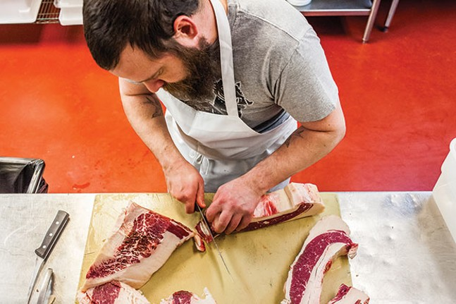 Jason Wilcox, the new in-house butcher at the Good Faith Restaurant Group - CP PHOTO BY VANESSA SONG