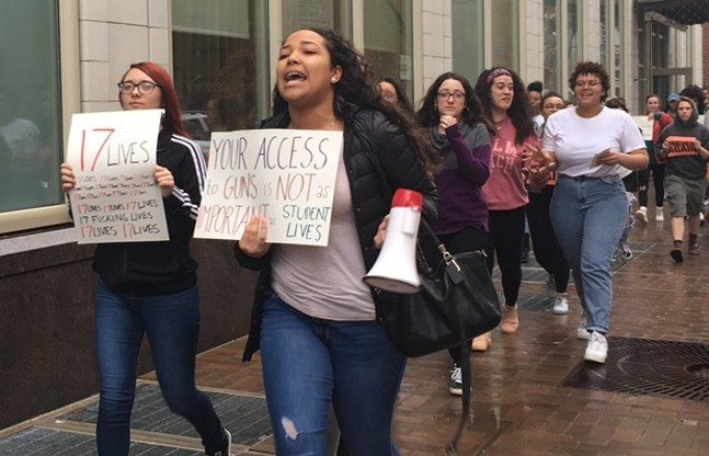 CAPA students march through Downtown Pittsburgh. - CP PHOTO BY SABRINA BODON