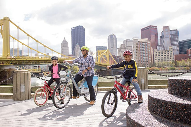 Family riding bikes in the North Side - PHOTO COURTESY OF PITTSBURGH BIKE SHARE