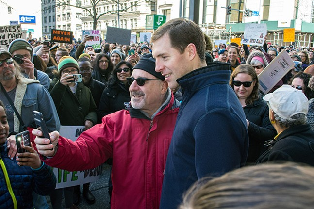 U.S. Rep-elect Conor Lamb (D-Mount Lebanon), right, with marcher - CP PHOTO BY JAKE MYSLIWCZYK
