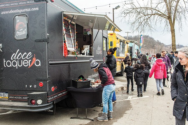 Doce Taqueria serves customer at Pittsburgh Food Truck Park - CP PHOTO BY VANESSA SONG