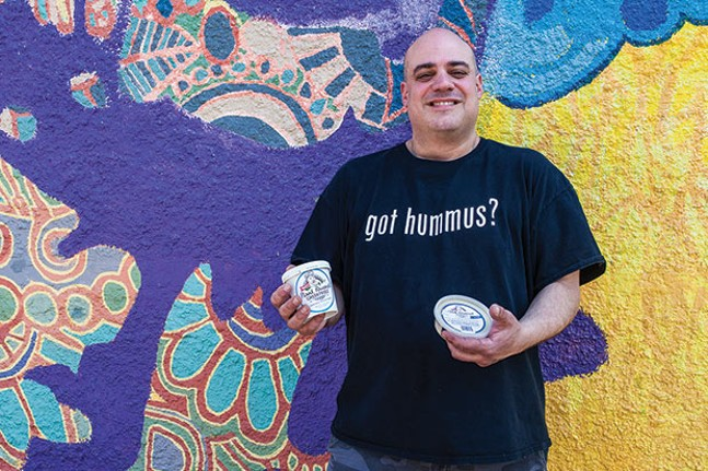 Michael Smalis, owner of Greek Gourmet, with his aquafaba ice cream - CP PHOTO BY VANESSA SONG