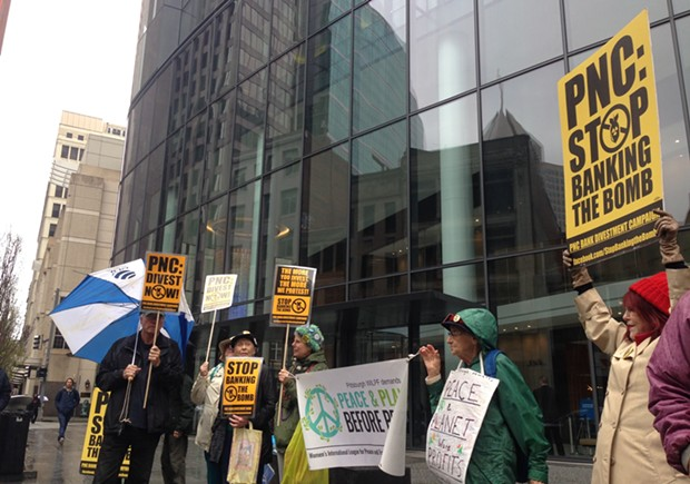 Anti-nuclear weapons protesters outside of PNC Tower on April 24 - CP PHOTO BY RYAN DETO