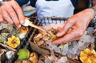 Shucking oysters - CP PHOTO BY VANESSA SONG