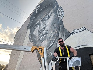 Jeremy Raymer in front of his Roberto Clemente mural - CP PHOTO BY LISA CUNNINGHAM