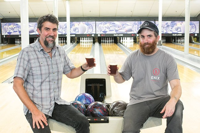 Victor and David Rodriguez inside the bowling alley at Enix Brewing Company - CP PHOTO BY JOHN COLOMBO