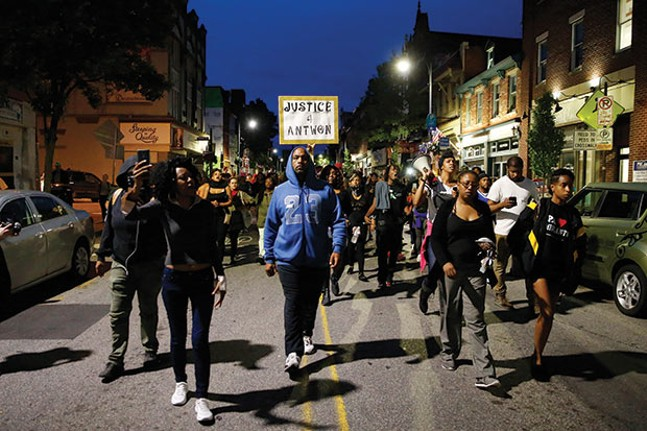 Protesters take to the street - CP PHOTO BY JARED WICKERHAM