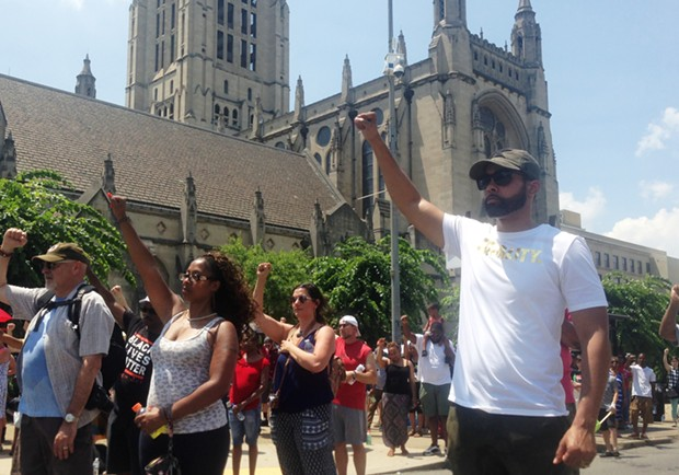 Activist Jasiri X (right) and others protested Sunday outside of East Liberty Presbyterian Church - CP PHOTO BY RYAN DETO