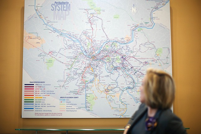 Katharine Eagan Kelleman put a system map up in her office to remind her employees of the importance of every person they serve. - CP PHOTO BY JARED WICKERHAM