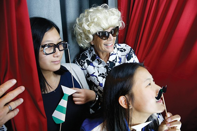 Guests wear props inside the photobooth at The Andy Warhol Museum. - CP PHOTO BY JARED WICKERHAM