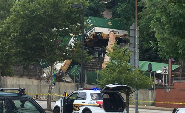 The derailed double-stack freight train in Station Square - CP PHOTO BY ALEX GORDON