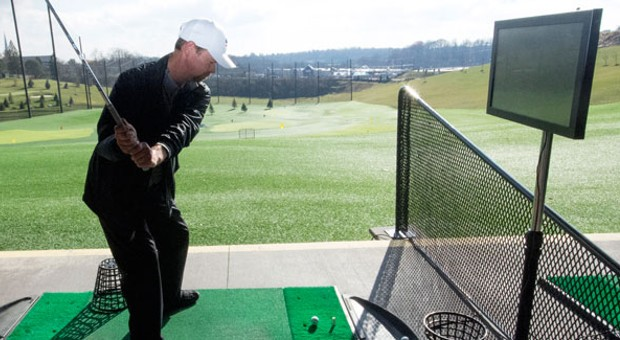 New technology at a South Hills driving range helps winter golfers simulate the real golf-course experience.