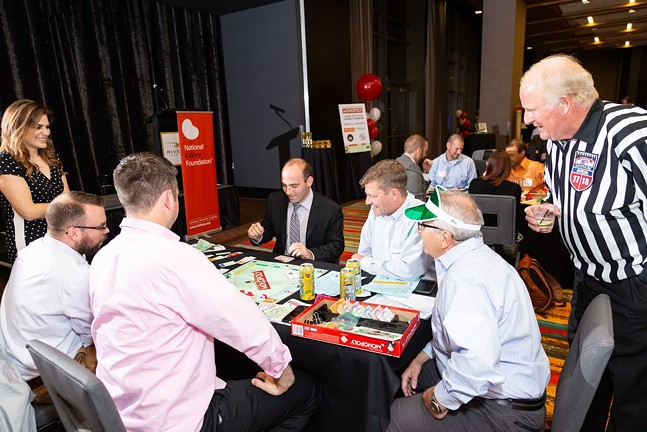 The official Pittsburgh Penguin Refs join the fun at NKF Corporate Monopoly Tournament!