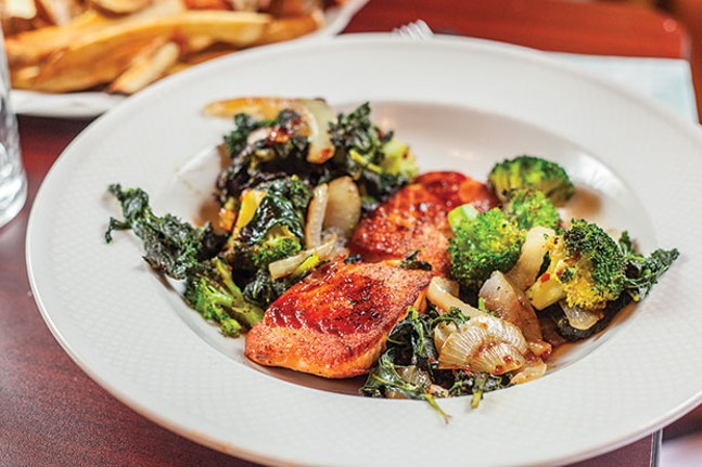 Seared salmon with an Asian-style glaze, sautéed greens and broccoli