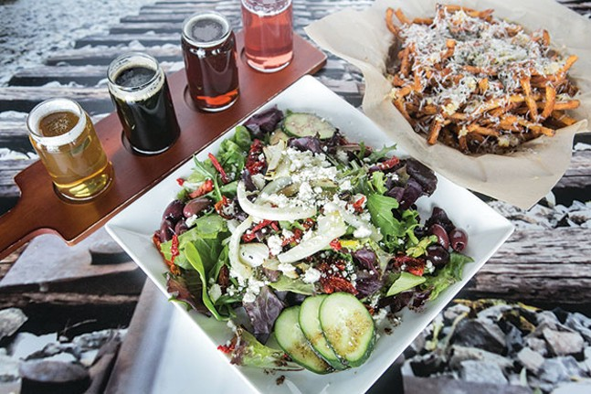 Mediterranean salad, garlic-parmesan fries and a beer flight