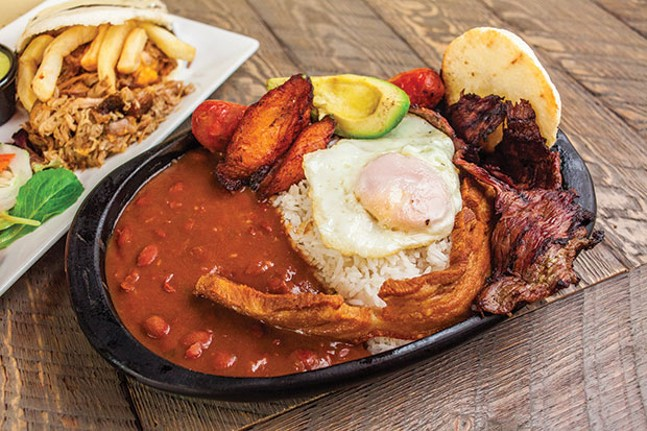 Bandeja Paisa: Steak, Colombian chorizo, fried pork belly, plantains, avocado, egg, red beans, rice and grilled arepa