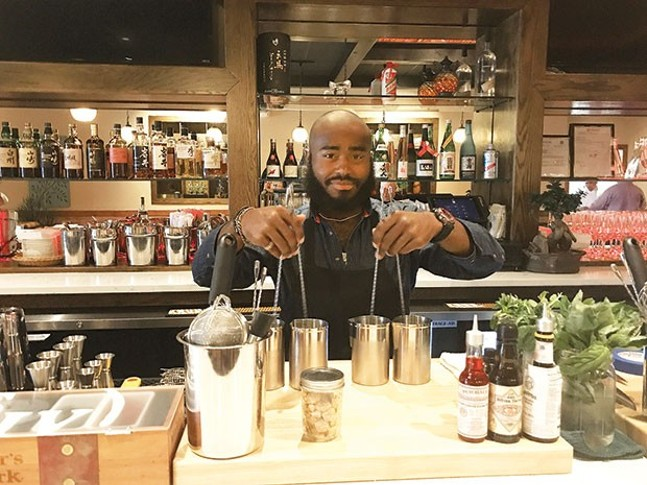 Beverage director Alec El behind the bar at Yuzu Kitchen