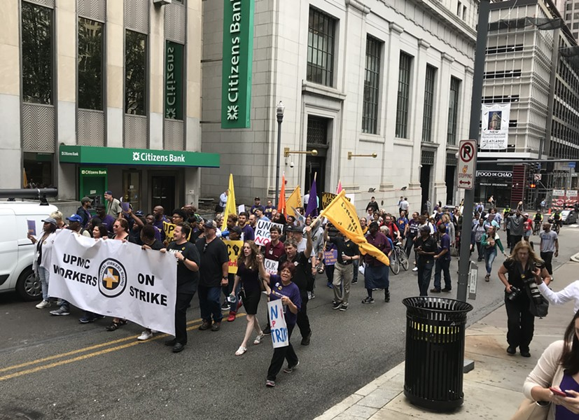 UPMC workers marching Downtown during their one-day strike - CP PHOTO: RYAN DETO