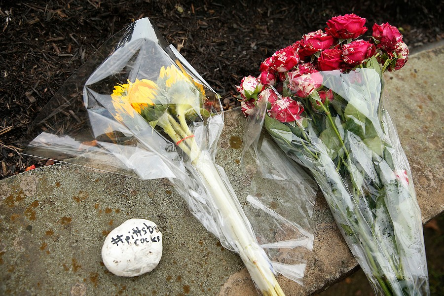 Flowers are left at a nearby intersection following a mass shooting at the Tree of Life Synagogue in Squirrel Hill on Sat., Oct. 27. - CP PHOTO: JARED WICKERHAM