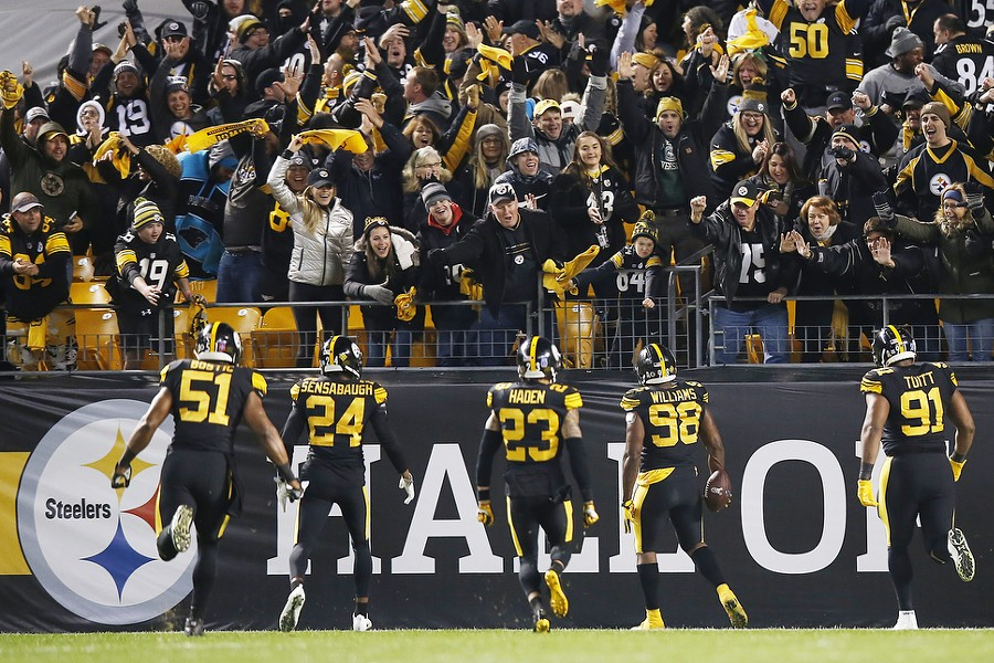 Vince Williams and the Steelers defense celebrate a pick six. - CP PHOTO: JARED WICKERHAM