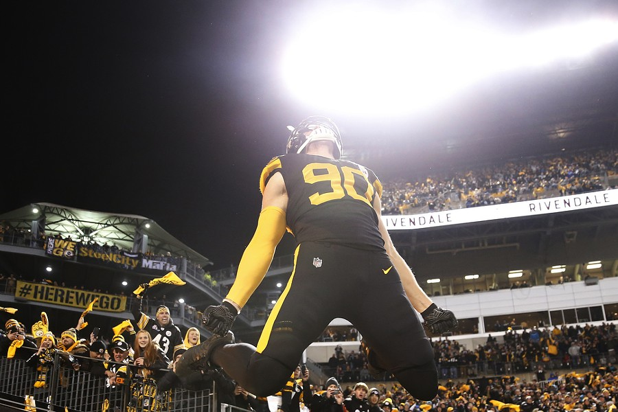 T.J. Watt leaps onto Heinz Field during his introduction. - CP PHOTO: JARED WICKERHAM