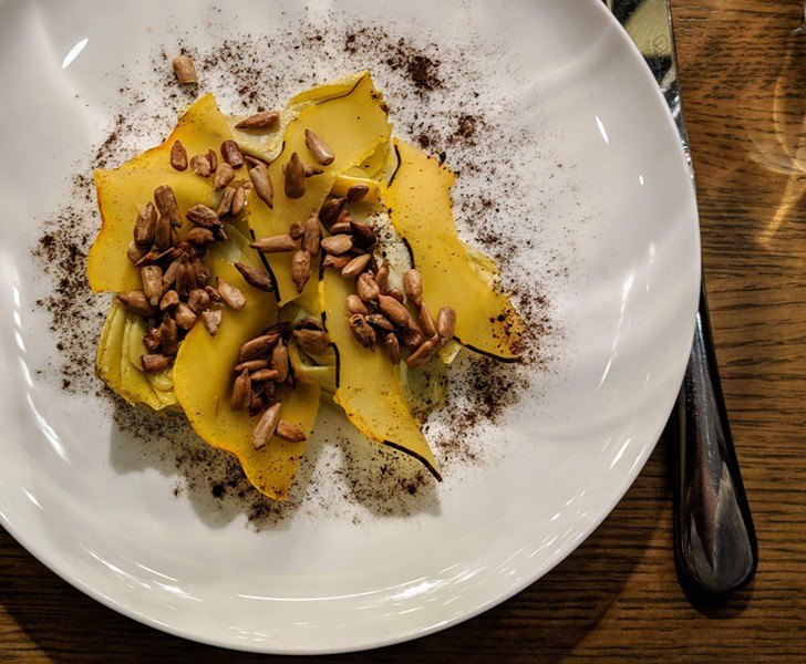 Artichoke topped with sunflower seeds, smoked brined carnival squash, and a dusting of vegetable ash - CP PHOTO: MAGGIE WEAVER