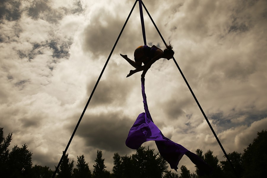 Carmel Ricketts, a student with Iron City Circus, performs aerials with silks following the People's Pride parade. - CP PHOTO: JARED WICKERHAM