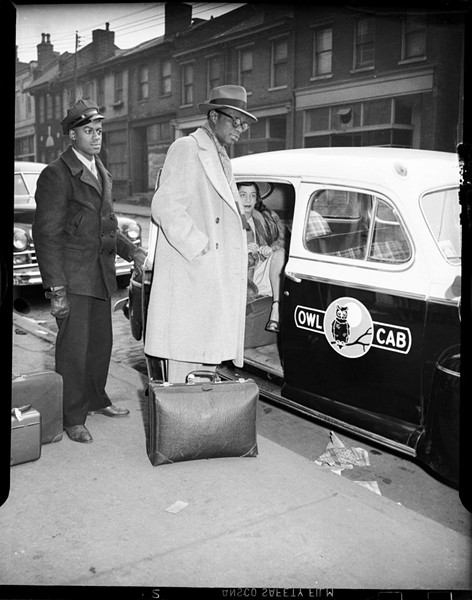 """""""Nat King Cole and Maria Cole with Owl Cab and driver, Hill District, February 1947,"""" a photo by Teenie Harris. Photo courtesy of the Heinz Family Fund - CARNEGIE MUSEUM OF ART"""