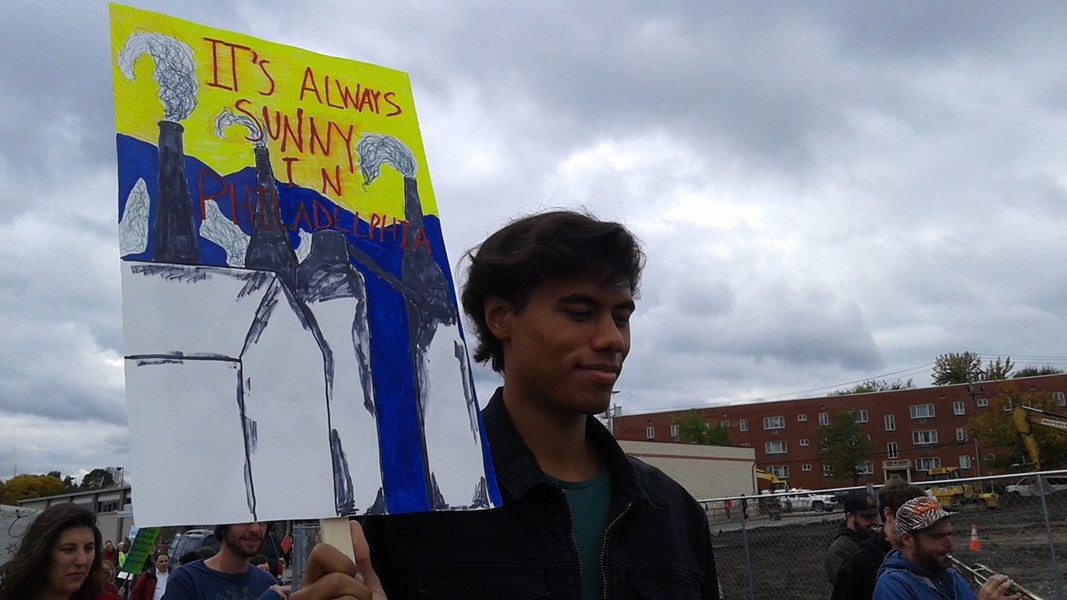 Cameron Heydar, of Chatham University's  Sustainable Impact Team, marched in the Oct. 14 Pittsburgh Climate Movement protest at Keith Rothfus' office. - PHOTO BY ASHLEY MURRAY