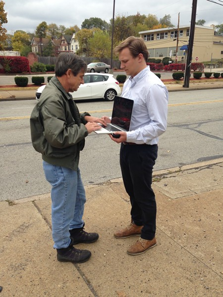 Joe Sestak and his intern set up a mobile desk strategy so Sestak can respond to emails on Fifth Ave. in Larimer. - PHOTO BY RYAN DETO