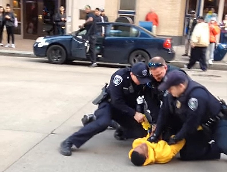Police take an individual into custody on Liberty Avenue Wednesday - IMAGE FROM VIDEO BY RYAN DETO