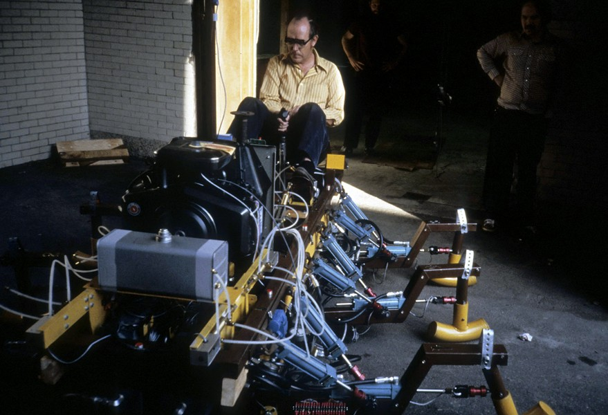 "Ivan Sutherland rides his original ""Trojan Cockroach,"" a six-legged hexapod walking machine. - DANIEL PILLIS"