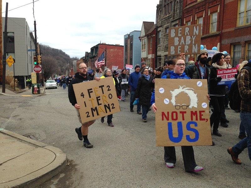 Pittsburghers march down Fifth Avenue in Uptown in support of Bernie Sanders. - PHOTO BY RYAN DETO