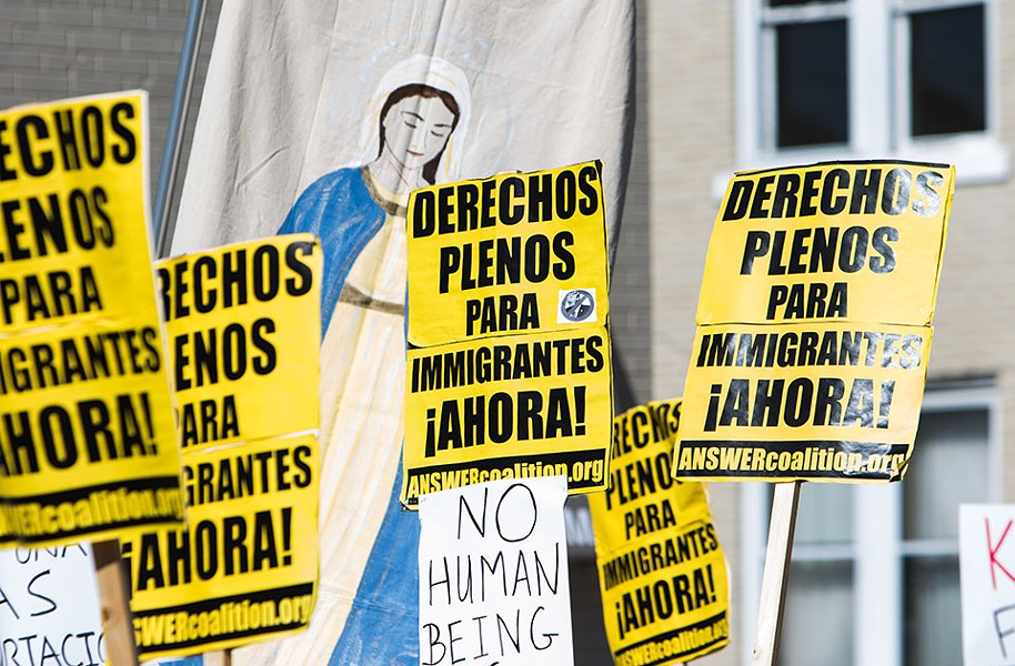 """Signs at a Sept. 25 rally in Beechview read, """"Full rights for immigrants now."""" - CP PHOTO BY LUKE THOR TRAVIS"""