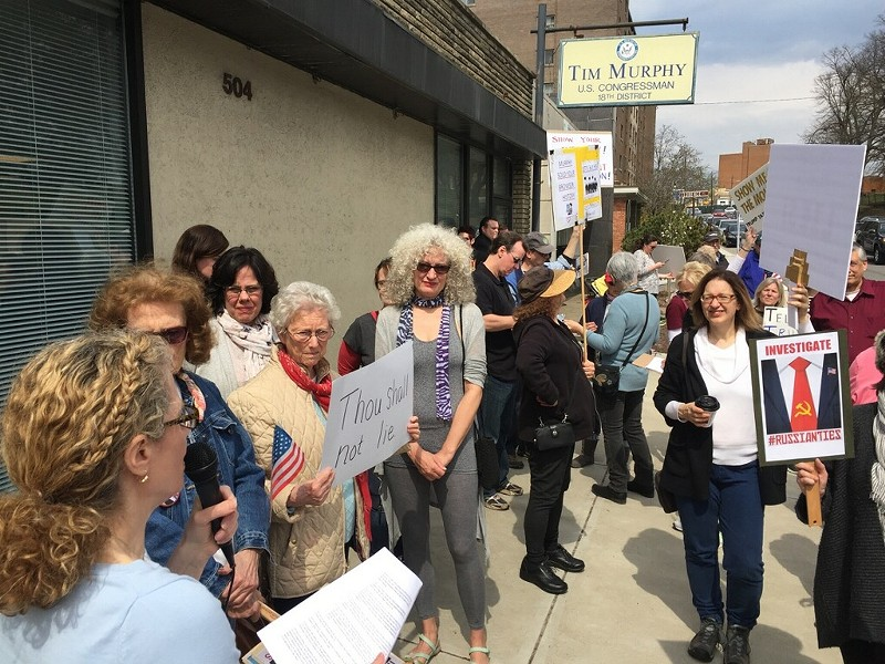 Consituents rally in front of U.S. Rep. Tim Murphy's Mount Lebanon office. - PHOTO COURTESY OF MYKIE REIDY