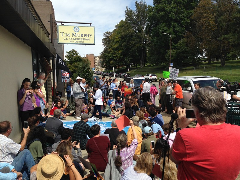 Dozens gather outside Tim Muprhy's Mount Lebanon office to protest Trump's DACA decision - CP PHOTO BY RYAN DETO