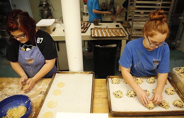 Sara Mesko and Summer Wood prepare cookies inside Nancy B's. - CP PHOTO: JARED WICKERHAM