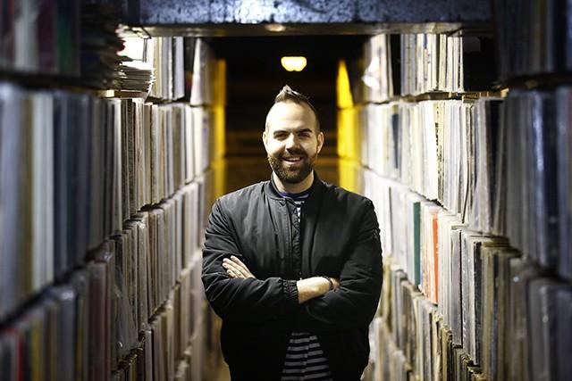 Nick Barilla inside Millvale's Attic Record Store - CP PHOTO: JARED WICKERHAM