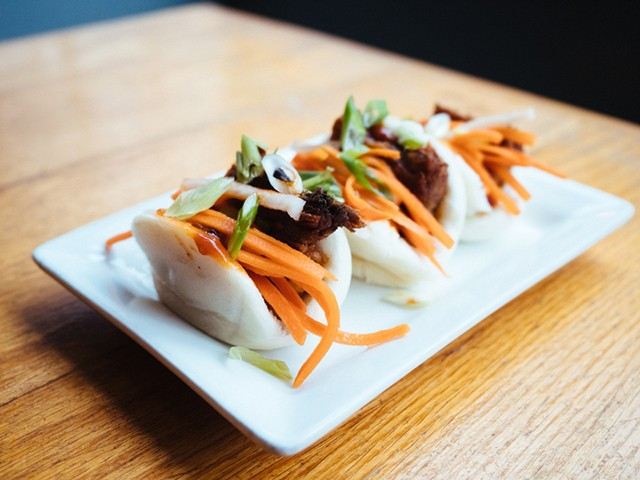 Pork belly steamed buns with pickled carrots, daikon radish, scallions, and Thai BBQ sauce - CP PHOTO: JARED MURPHY
