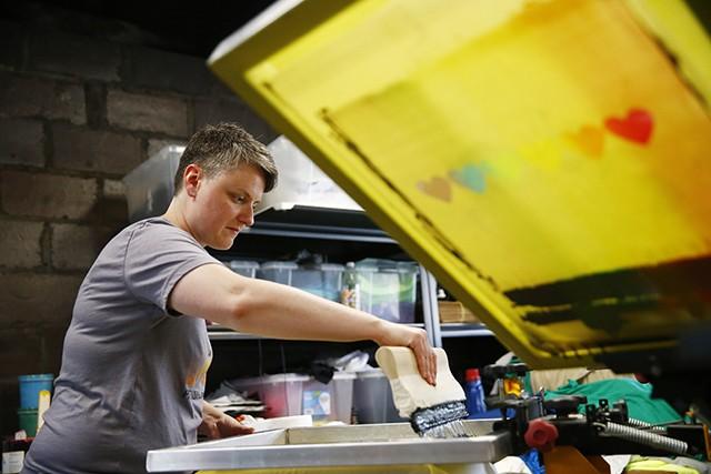Joyce Swope screen prints shirts in Etna Print Circus' garage workshop - CP PHOTO: JARED WICKERHAM