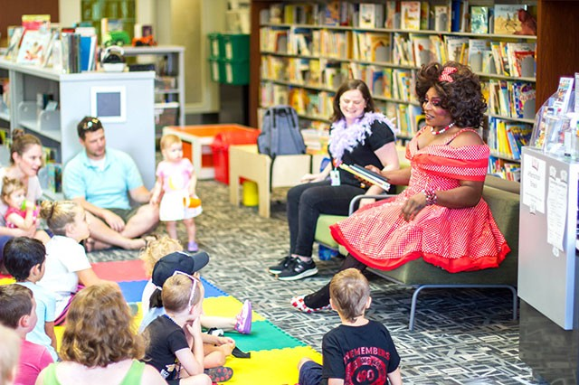 Akasha L Van-Cartier reads to kids at Drag Queen Story Hour