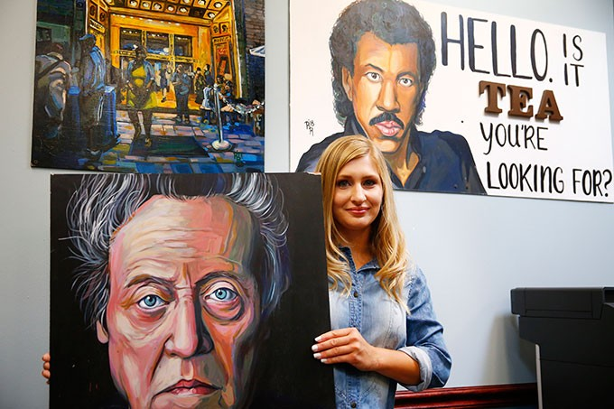 Rachel Dawn Renaudin poses with her artwork. - CP PHOTO: JARED WICKERHAM