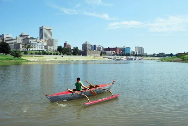 "Michael Arcega guides his canoe ""Baby: Corps of Re-Discovery"" downstream - PHOTO COURTESY OF THE DOLLAR BANK THREE RIVERS ARTS FESTIVAL"