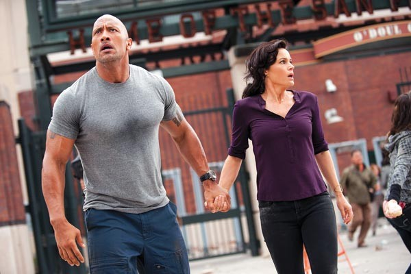 Can this marriage be saved? Dwayne Johnson and Carla Gugino ride out the Big One.