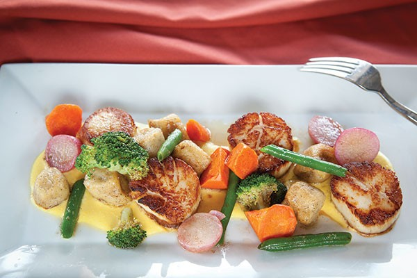 Seared scallops with house-made potato gnocchi and summer vegetables in honey-corn cream sauce - PHOTO BY HEATHER MULL