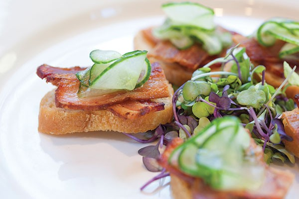 Crostini with cucumbers and house-cured bacon - PHOTO BY HEATHER MULL