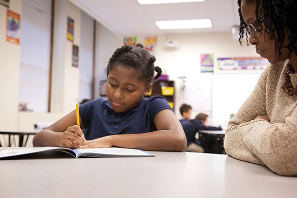 LaShawn Neal works with a student at Propel East - PHOTO BY HEATHER MULL