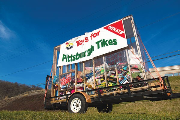 The Toys for Pittsburgh Tikes donation trailer sits outside of Jaden's Catering on Route 22 in Monroeville. - PHOTO BY THEO SCHWARZ